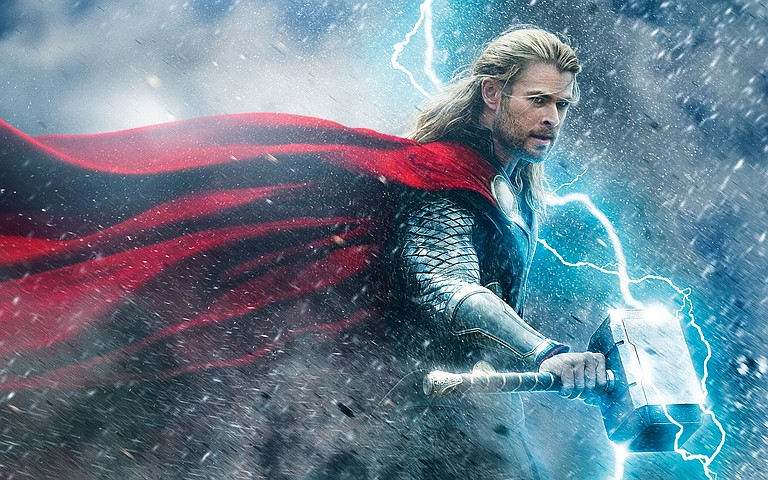 "As the title character, Chris Hemsworth wields a mighty hammer in ""Thor: The Dark World."""