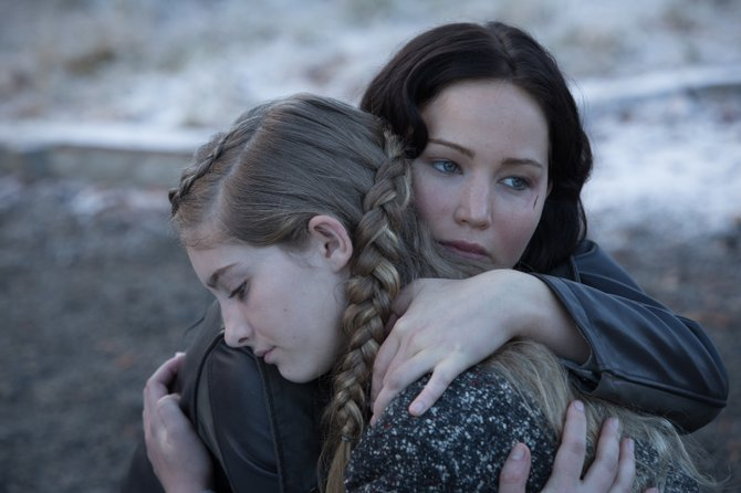 "In ""The Hunger Games: Catching Fire,"" Katniss Everdeen (Jennifer Lawrence, right) once again finds herself fighting to save her sister Prim (Willow Shields, left)."