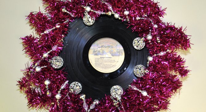 In search of the tackiest wreath I could come up, I decided to pay homage to Miss Donna Summer, Disco Queen. I glued the most scratched album I could find of hers behind a used pink wreath form, tied around a silver bead-garland and added disco-ball ornaments. Hint: Use this for inspiration to dress for the next Best of Jackson party. —D.L.