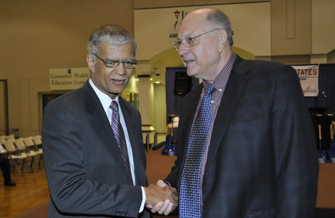 Jackson Mayor Chokwe Lumumba and Clarence Chapman, president of Chartre Consulting Ltd., helped break ground on a downtown housing development that Lumumba called part of an intelligent urban renewal plan.