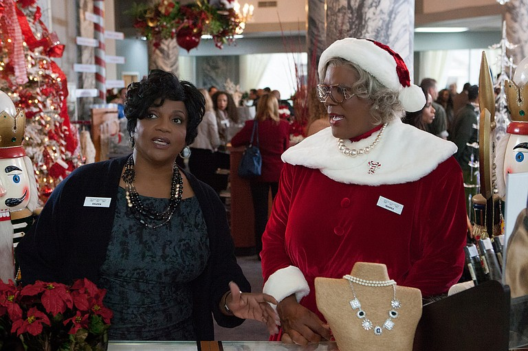 """Tyler Perry (right, with Anna Maria Horsford) reprises his cross-dressing role of Madea for a silly seasonal romp in """"Tyler Perry's A Madea Christmas."""""""