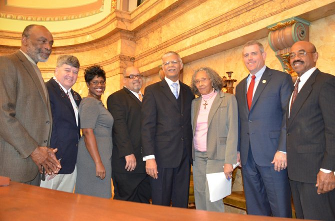 Jackson Mayor Chokwe Lumumba welcomed lawmakers and encouraged them to spend money in the capital city. Pictured, from left: Rep. Jim Evans, D-Jackson, Speaker Pro Tempore Rep. Greg Snowden, R-Meridian,  Rep. Adrienne Wooten, D-Jackson, Rep. Earle Banks, D-Jackson, Lumumba, Rep. Alyce Clarke, D-Jackson, Speaker Philip Gunn, R-Clinton and Rep. Credell Calhoun, D-Jackson.
