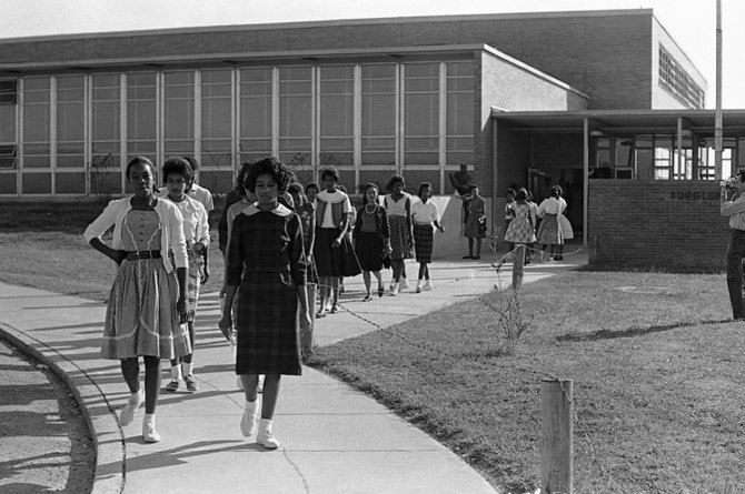 Burglund students walk out of their school in McComb, Miss., in 1961. (Associated Press)