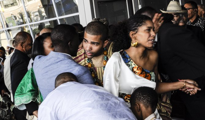 Chokwe Antar Lumumba (left) and Rukia Lumumba (right) greet people at their father's funeral.