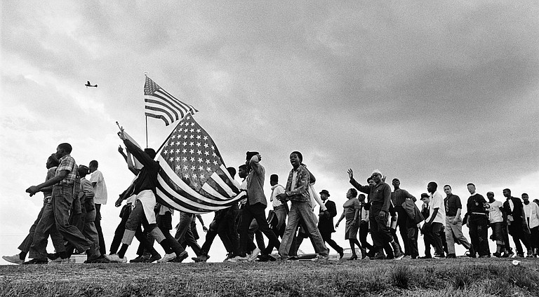 """""""Selma to Montgomery,"""" Matt Herron, 1965. The work of Herron and other activist photographers during the Civil Rights Movement will be showcased at """"This Light of Ours,"""" showing at the Mississippi Museum of Art through August 17."""