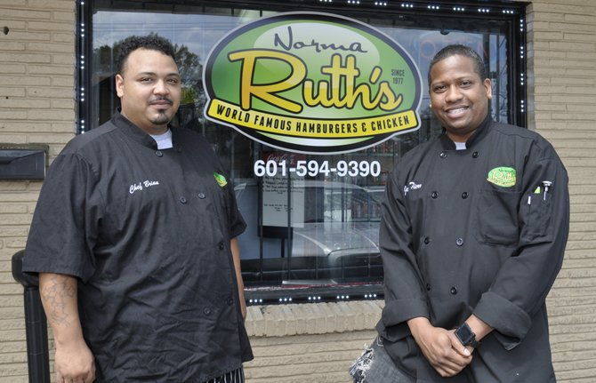 """Norma Ruth's chef Brian Myrick (left) and owner John """"Stax"""" Tierre (right) offer up rib-eye steaks, wings, burgers, seafood such as shrimp and crab claws, and more."""