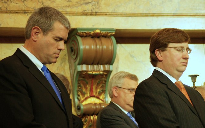In this file photo, Mississippi Speaker Philip Gunn and Lt. Gov. Tate Reeves pray before Gov. Phil Bryant (not pictured) took the oath of office in January 2012.
