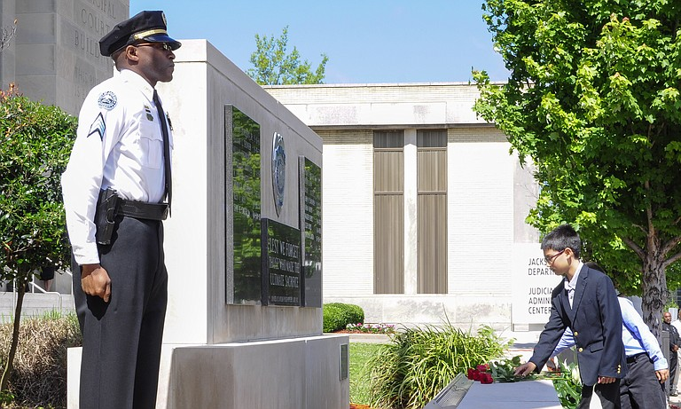 The JPD memorial was held outside of the department's headquarters downtown. Deputy Chief Dwayne Thomas served as the program officer, and Mayor Tony Yarber made special remarks to the families of the late officers.