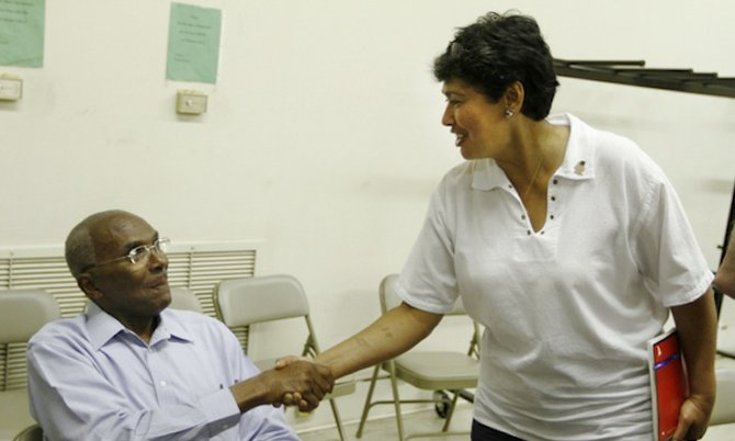 Magnolia Mayor Melvin Harris (left) and Mercedes Ricks