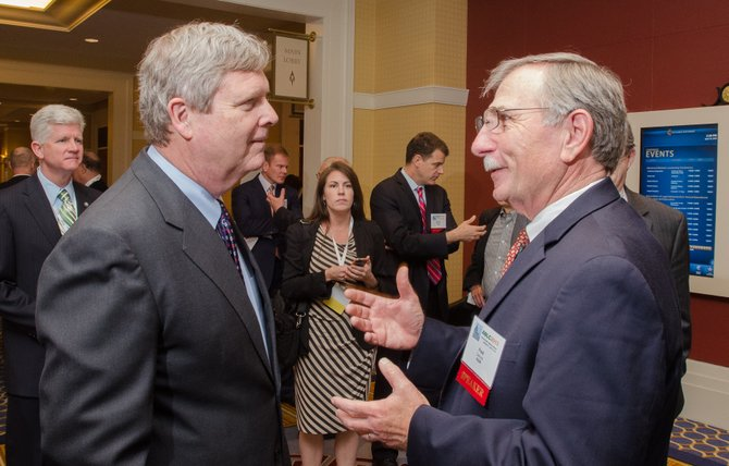 U.S. Agriculture Secretary Tom Vilsack (left) meets with KiOR CEO Fred Cannon at a 2013 biofuels conference.