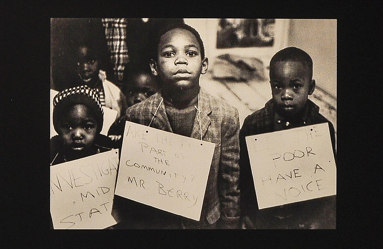 Children hold anti-poverty and voting rights signs during the Civil Rights Movement.