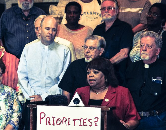 Brenda Scott, president of the Mississippi Alliance of State Employees, a labor organization, questioned whether state politicians are really doing God's work in Mississippi.