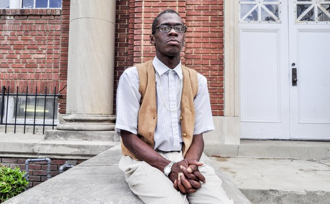 Timothy Randall Lewis, Jr. waits outside of Stewpot on West Capitol street. He hopes to get a meal to eat.