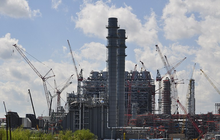 Southern Co. said Thursday that it will cost at least another $59 million to finish the power plant it's building in eastern Mississippi's Kemper County, pushing the total cost above $5.6 billion.