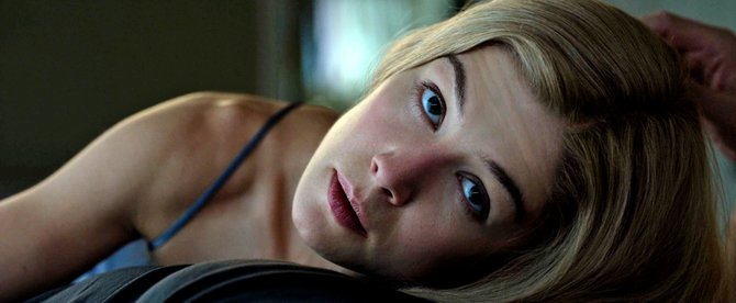 """Director David Fincher's expertly written and acted thriller, """"Gone Girl,"""" starring Ben Affleck and Rosamund Pike, is a timely tale of marriage, suspicion and modern media that covers an impressive amount of thematic ground."""