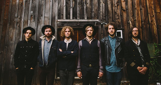 Singer-songwriter Daniel Blue (fourth from left) leads Seattle's Motopony on a musical whim as he leaps through contradicting genres with abstract lyricism.