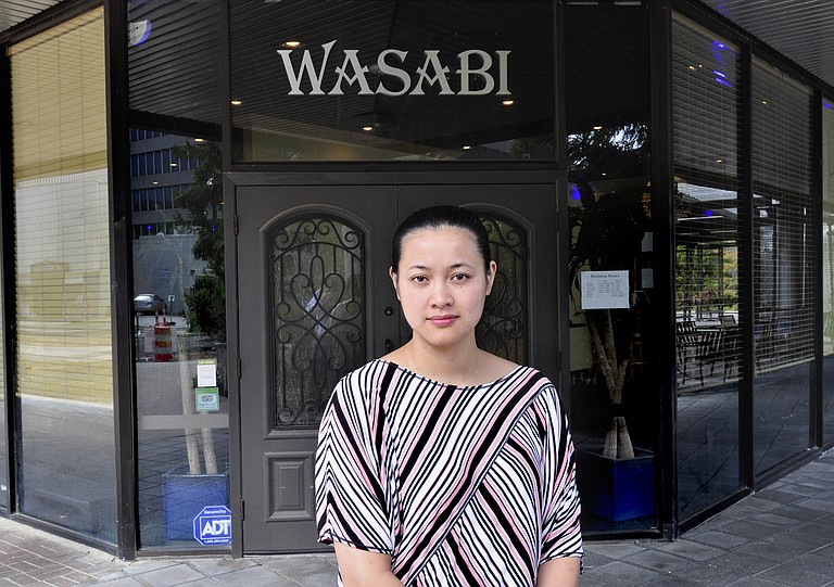 Lina Lynn, owner of Wasabi Bistro, wonders how much longer her three-year-old restaurant on West Capitol Street can hold out without help from the city or an uptick in the number of people working downtown.