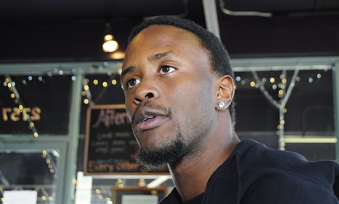 Byron Johnson, 22, works at a McDonald's in Jackson and says earning minimum wage allows him to barely scrape by. He recently joined a national campaign to pay fast-food workers $15 per hour and plans to participate in a Dec. 4 strike.