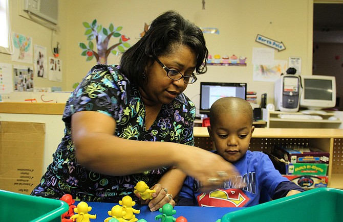 Jennifer Calvert, director of the ABC Pre-School & Nursery Inc. in Aberdeen, Miss., helps a student build a pattern during a morning activity earlier this year. Educators say early education is critical to fix Mississippi's education deficiencies. Photo courtesy Jackie Mader