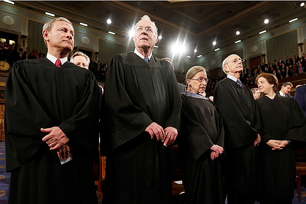 The Supreme Court is assessing Oklahoma's use of a sedative used in its three-drug lethal injection protocol. Above, Chief Justice John Roberts, left, stands with fellow Justices Anthony Kennedy, Ruth Bader Ginsburg, Stephen Breyer and Elena Kagan before President Obama's State of the Union speech in January 2014. Photo courtesy Larry Downing/Pool/Getty Images