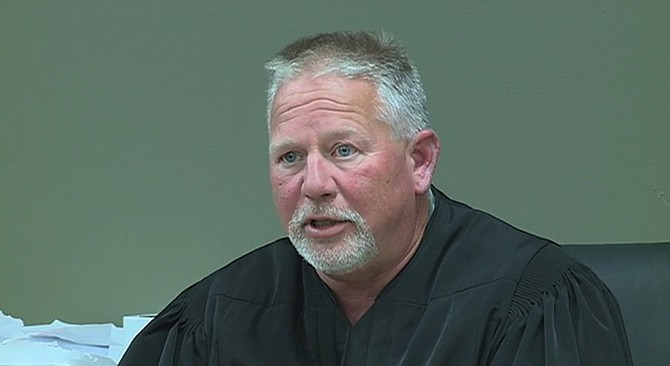 """Madison County Justice Court Judge Bill Weisenberger is being accused of knocking down, slapping and kicking a mentally disabled young black man and yelling a racial slur: """"Run, n*gger, run."""" Photo courtesy WAPT News Channel 16"""