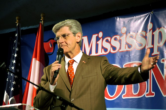 First-term Gov. Phil Bryant picked up a Republican primary challenger Thursday, the day before candidates' deadline to qualify for statewide, regional and legislative races.