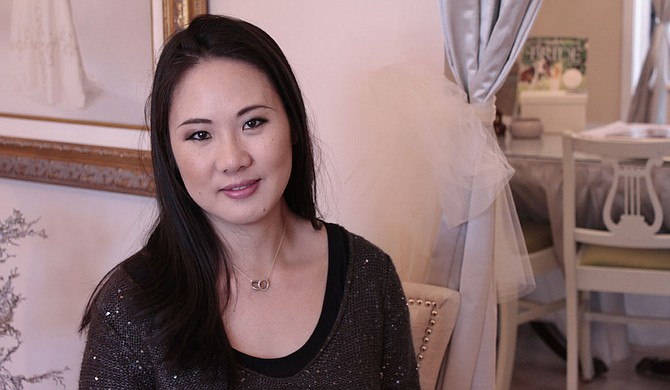Samantha Woo of Woo Couture loves custom designing wedding dresses for her brides. Photo courtesy Amber Helsel