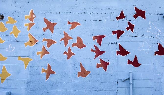 Margaret Sullivan designed the mural outside of Stewpot Community Service's Opportunity Center.