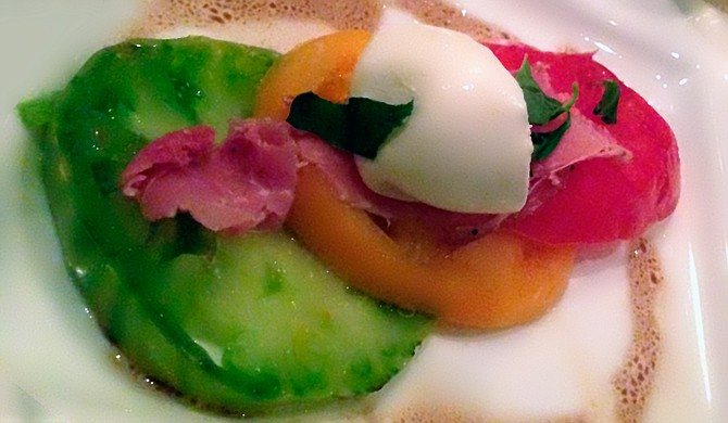 At 1908 Provisions' March 4 Chef's Table dinner, Chef Gary Hawkins offered diners seasonal dishes such as  this one made with heirloom toma-toes, burrata, prosciutto and basil.