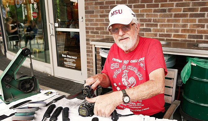 Jim Burwell, who owns Burwell Blades, has set up many Saturdays outside of Whole Foods Market to sharpen blades for people.