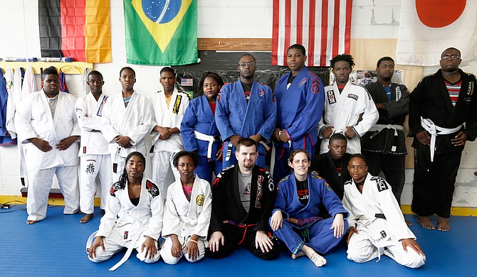 Participants in Chris and Beth Thrasher's Vector Jiu-Jitsu are like family. The couple offers encouragement and support, and helps their students learn to focus both in training and in school.