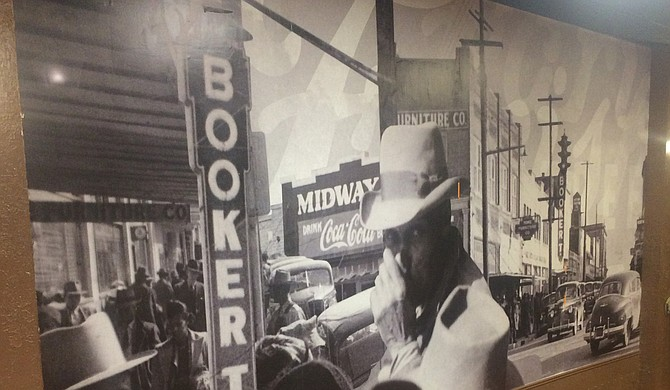 A mural on the wall of Johnny T's Bistro and Blues is made up of photographs of Farish Street in its prime. Photo courtesy John Tierre