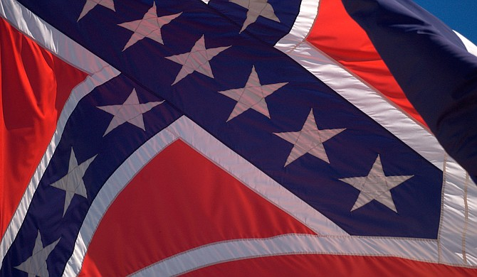 """""""The battle flag has to be removed from the state flag of Mississippi and from display anywhere other than museums, historical events and cemeteries."""" Photo courtesy Flickr/Stuart Seeger"""