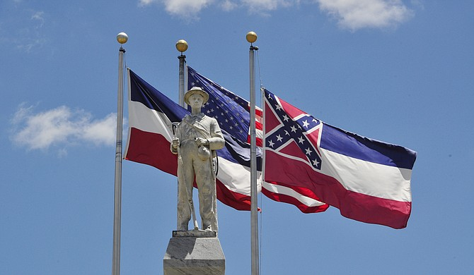 A statue of a Confederate solder stands in the square in downtown Brandon in front of a Mississippi flag containing the controversial Confederate battle symbol. Photo courtesy Trip Burns/File Photo