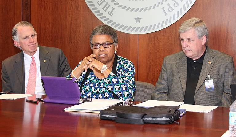 Constance Slaughter-Harvey, center, would have liked the committee to examine other aspects of the state's prison system. Also pictured are Andy Taggart (left) and Bill Crawford (right). Photo courtesy MDOC