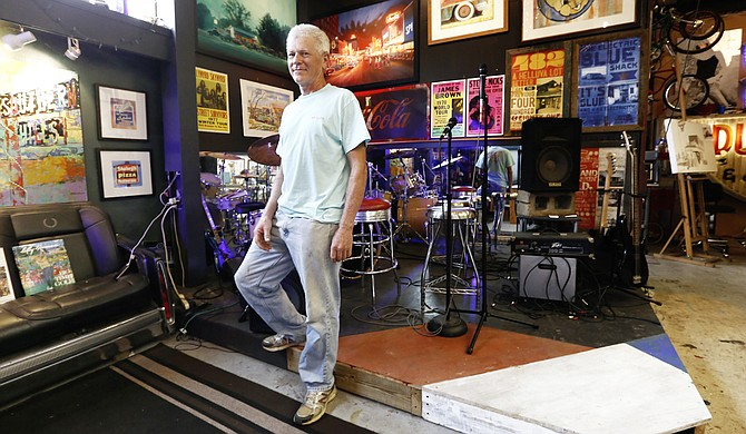 Mark Millet's art studio in Ridgeland is adapted from an old car garage, which he says gives him the space to paint, work on cars and display his drum kit.