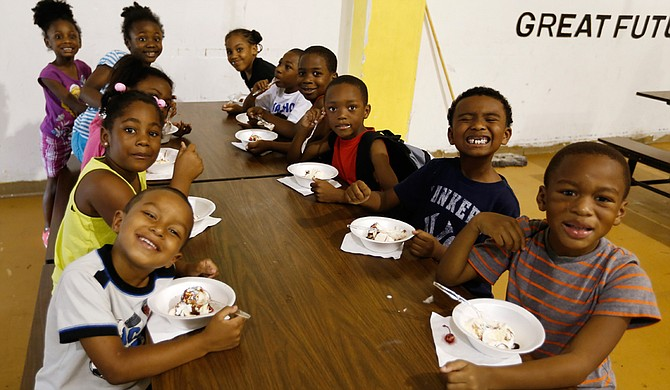 Six-year-olds in the Boys and Girls Club summer program eat ice cream courtesy of The Phoenix Club.