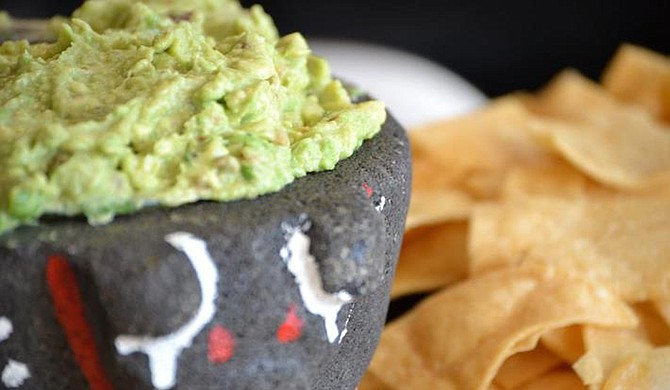 Folks crave Guacamole at Babalu Tacos & Tapas. Photo courtesy Babalu Tacos & Tapas
