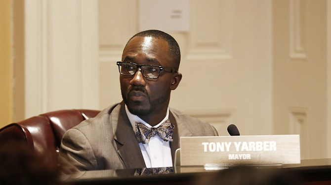 Mayor Tony Yarber proposes to balance a $495 million budget with an 8-percent hike in property taxes and employee furloughs.