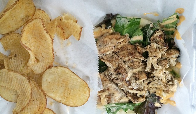 Grilled chicken pita with homemade potato chips Photo courtesy Emerald Alexis Ware