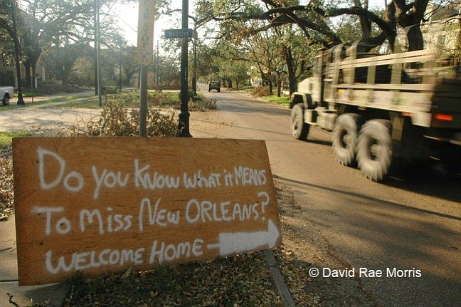 A military convoy drives  along St. Charles Avenue in Uptown New Orleans, Sept. 8, 2005.  The city was devastated when the levees broke after Hurricane Katrina made landfall in southeast Louisiana, flooding 80 percent of the city. Photo courtesy David Rae Morris