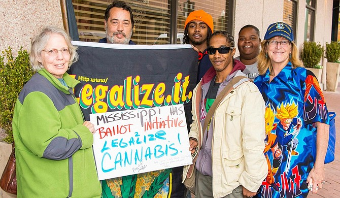 Kelly Jacobs (far right), one of the lead forces on Initiative 48 to legalize smoking and growing pot in Mississippi, fears organizers could miss the mark to put it on the 2016 ballot. Also pictured, from left to right, are: Susan Watkins, David Lions, Jamarcus Manning, Kassa Whitley and Shannon Smothers-Wansley. Photo courtesy Kelly Jacobs/File Photo