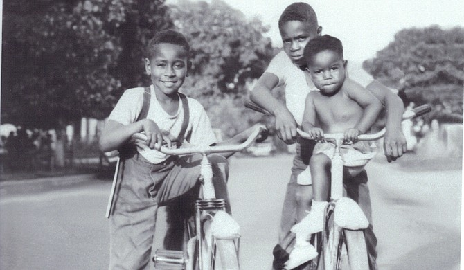 Cousins Emmett Till (left) and Wheeler Parker (back right) wheel around Argo-Summit, Ill., with family friend Joe B. Williams (front right). Parker said this photo was taken some time between 1949-1950. Photo courtesy Wheeler Parker Jr.