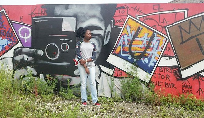 Jackson pop artist Adrienne Domnick (pictured in front of a mural in Bywater, New Orleans) often creates pieces that center on artists and musicians that she finds inspiring. Many of them are African Americans. Photo courtesy Mississippi Museum of Art