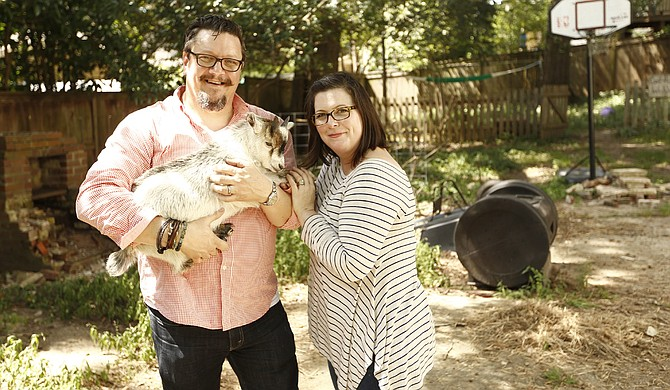 Chef Tom and wife Kitty Ramsey (left to right) with their pet goat Pat in Belhaven