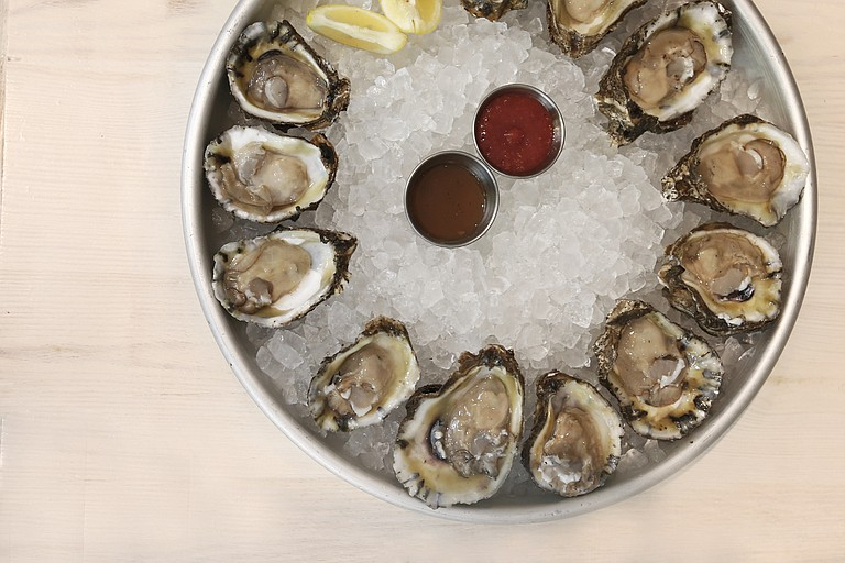 Half Shell Oyster House serves hand-shucked oysters raw, charbroiled, baked or broiled or on the half shell with a special blend of herbs and mushrooms or a spicy New Orleans-style buttery barbecue sauce to go with them.