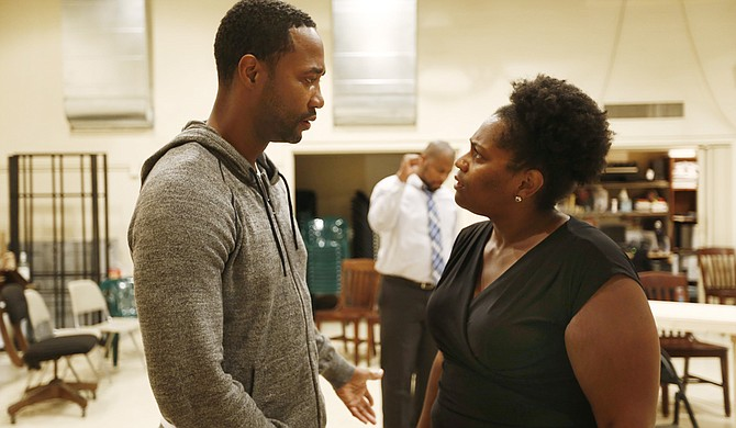 """Yohance Myles (left) and Sharon Miles (right) play Carl Lee Hailey and Gwen Hailey, a couple whose family is thrown into turmoil after Carl Lee murders his daughter's rapists and goes on trial in """"A Time to Kill"""" at New Stage."""