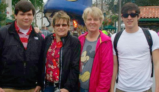 Lauren Czekala-Chatham (second from left) pictured with her partner, Dawn Miller, and two sons Aaron Chatham (far left) and Alec Chatham (far right) at DisneyWorld in Orlando in 2013. Photo courtesy Lauren Czekala-Chatham