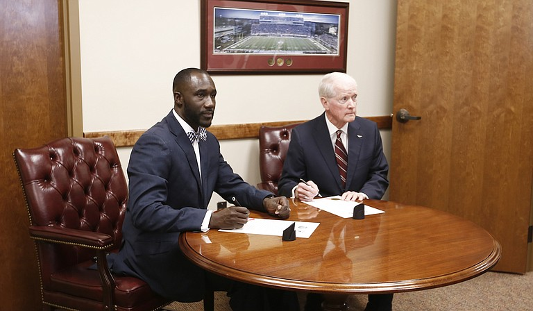 Jackson Mayor Tony Yarber (left) recently accepted $19.5 million from Mississippi Department of Transportation Commissioner Dick Hall (right) for infrastructure projects in Jackson, including those in the 1-percent sales tax master plan. Members of the Jackson City Council say constituents are already pressuring them to start spending the funds.