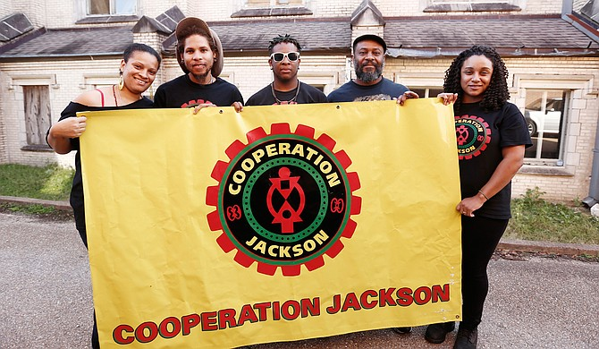 Sacajawea Hall, Brandon King, Elijah Williams, Kali Akuno and Fa'Seye Aina Gonzalez (left to right) are five members of a delegation Cooperation Jackson is sending to Paris for the upcoming COP21 Climate Conference.